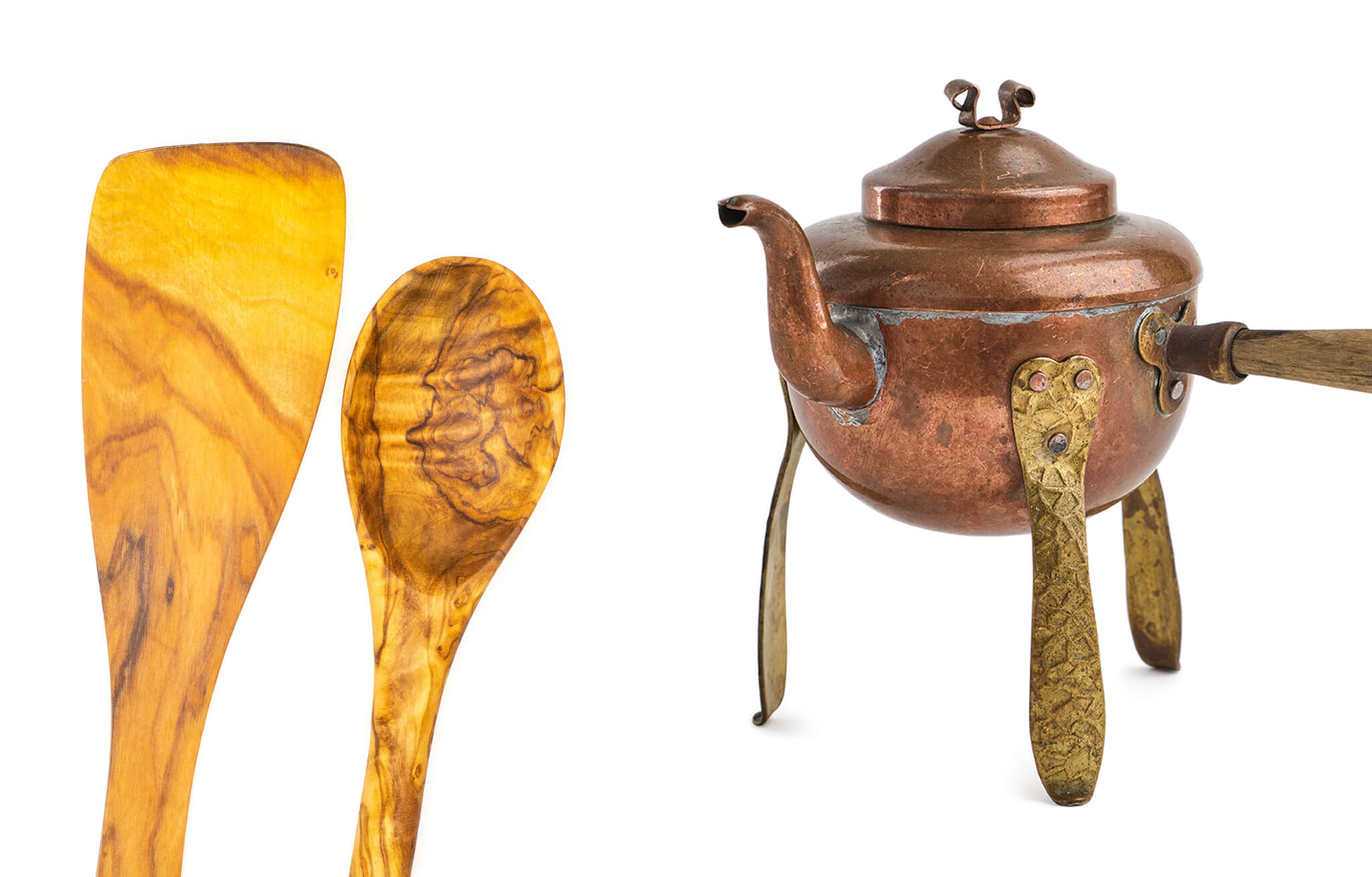 Mediterranean materials olivewood wooden spoon and copper metal teakettle