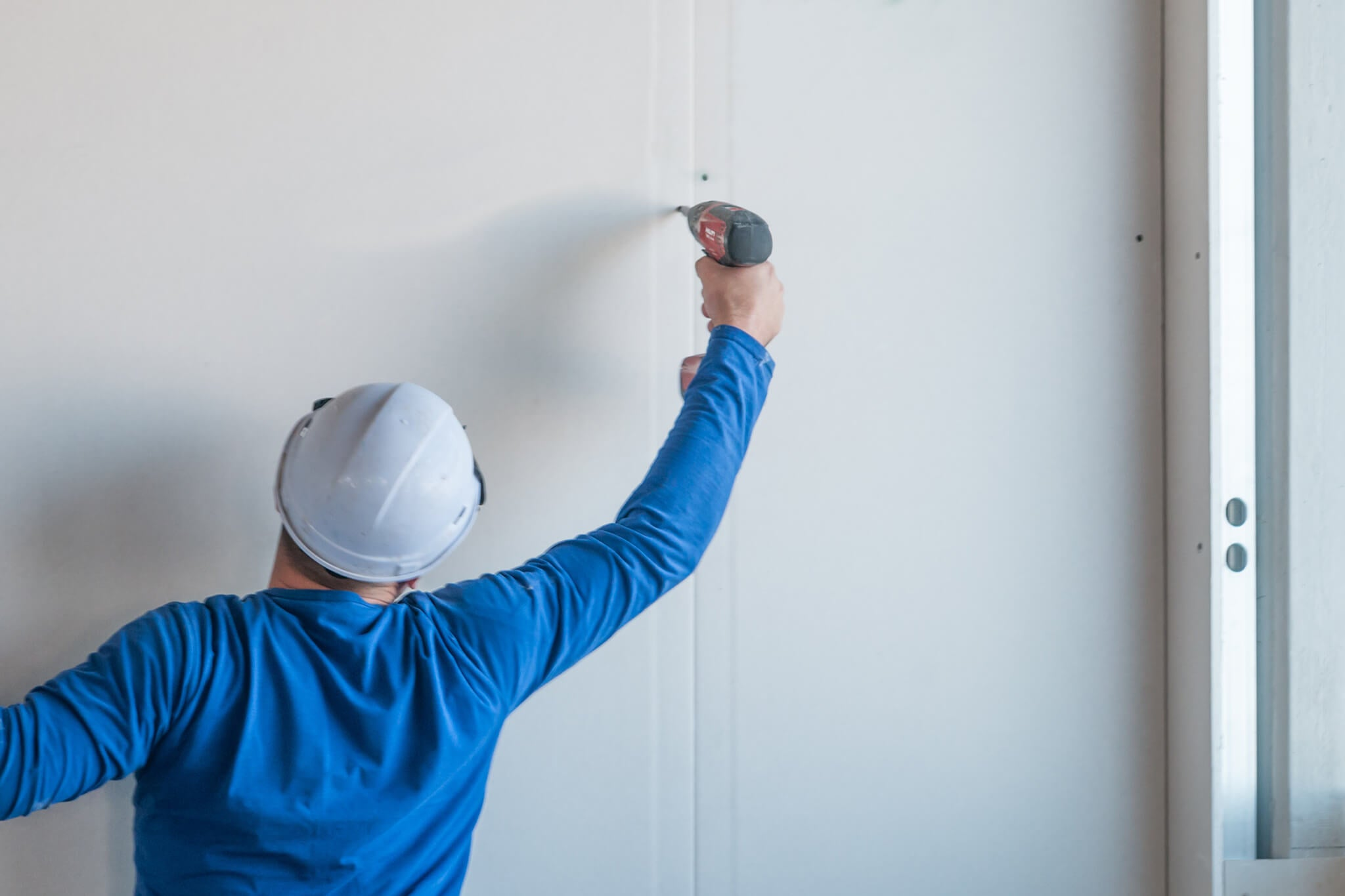 Installing the last drywall panel