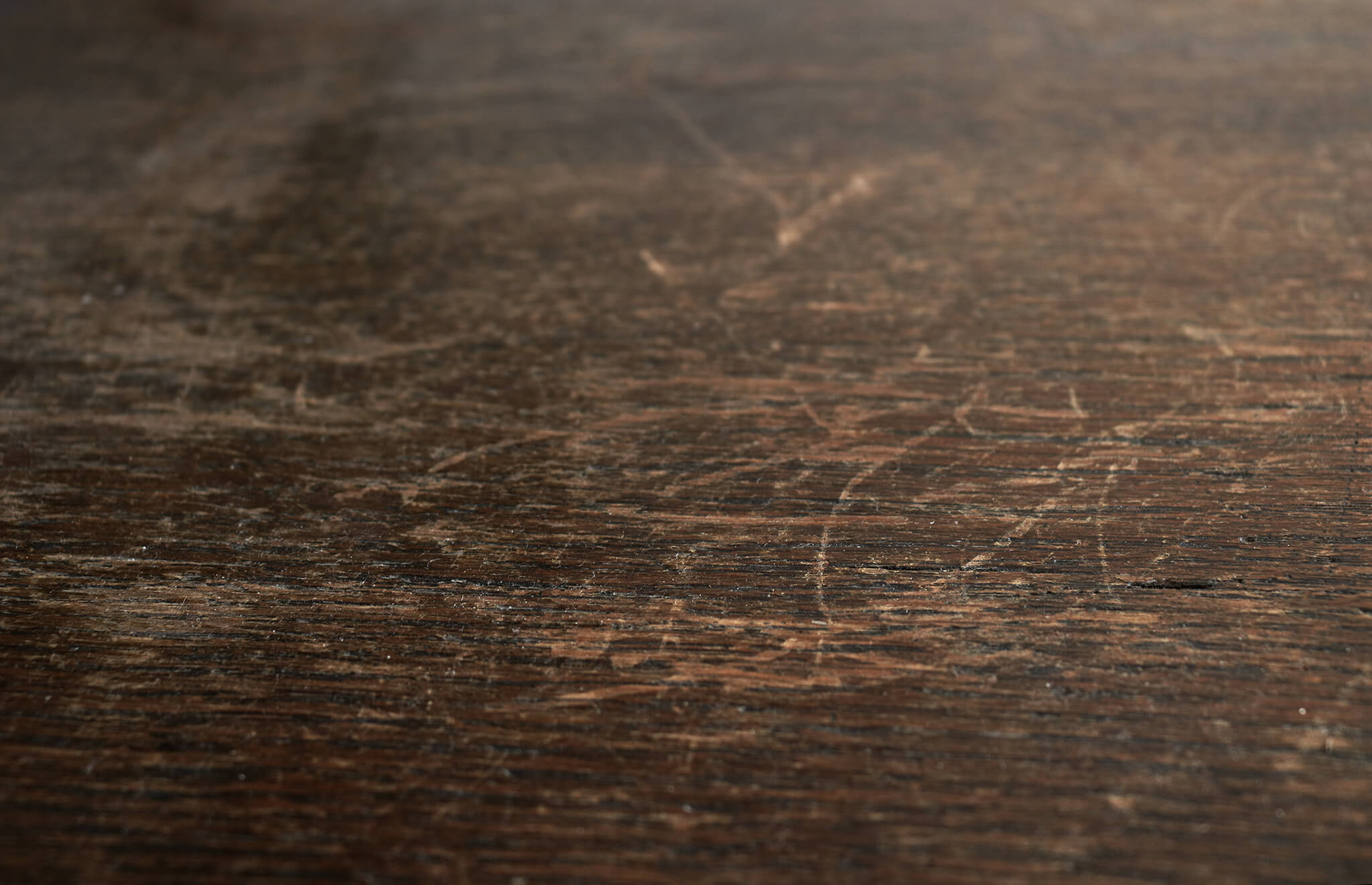 Scratches on Dark Wood