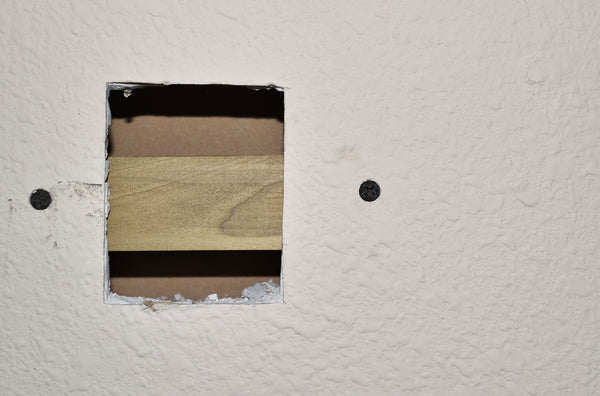 cutting a square hole into the drywall