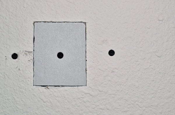 fitting the drywall square into the new hole