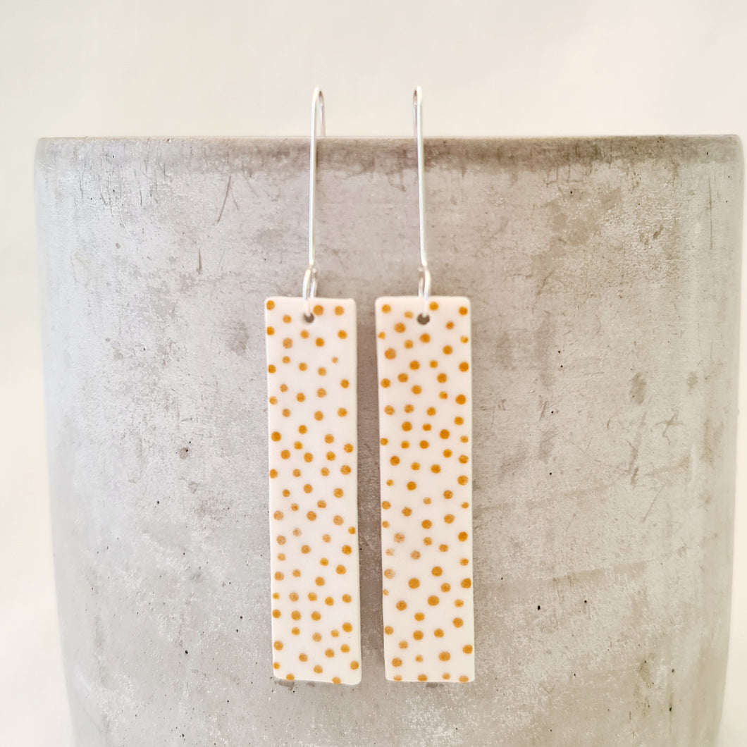 mustard dots on salt white | long column | long drops