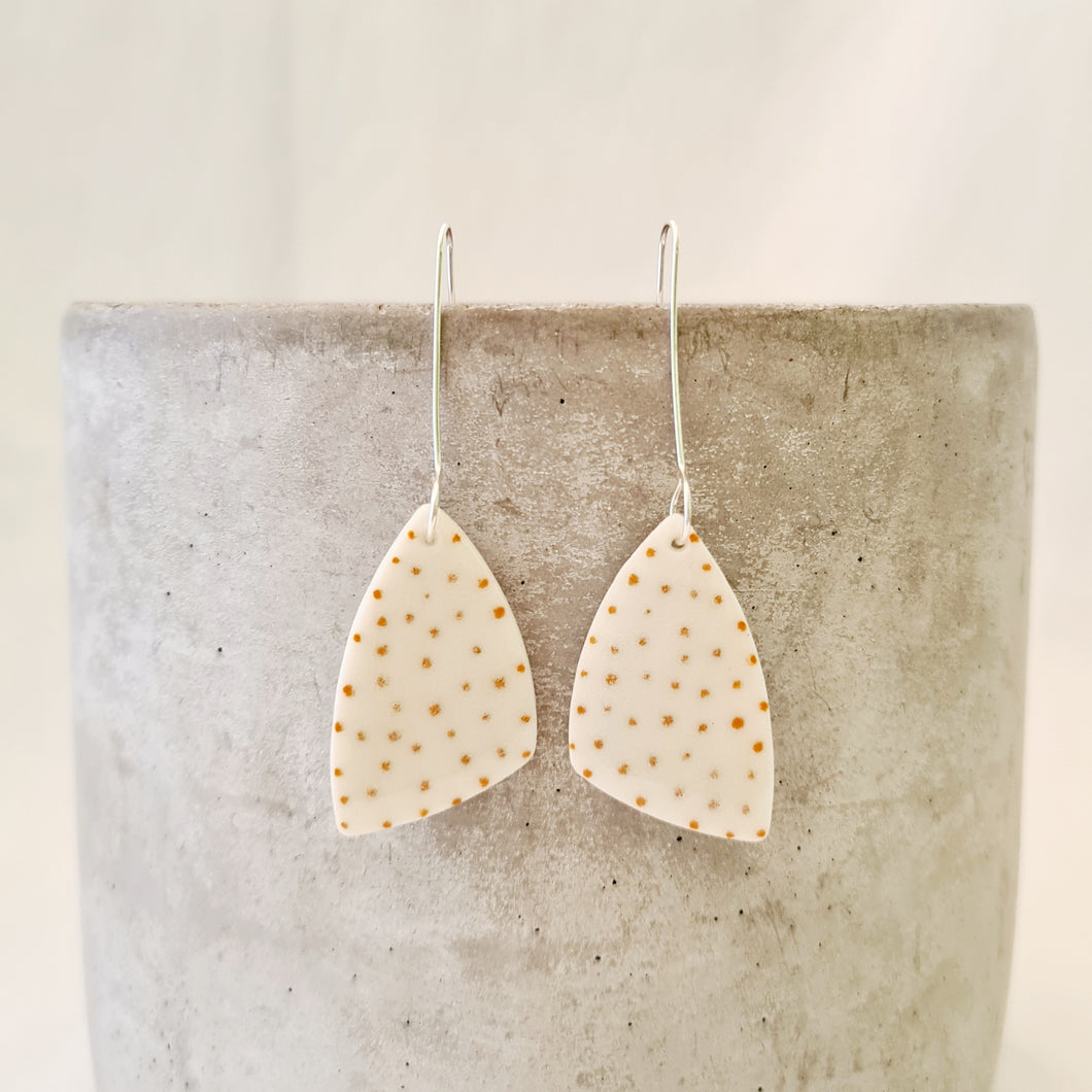 tiny mustard yellow dots - minimal | medium asymmetrical triangle