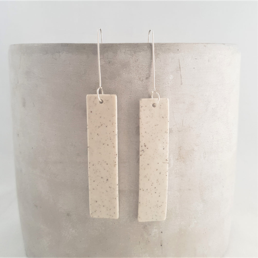 speckled clay | salt white glaze |  long column | long drops