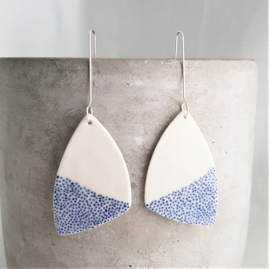 tiny electric blue dots | asymmetrical triangle | large