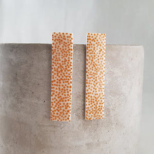 tiny mustard dots | long column | studs