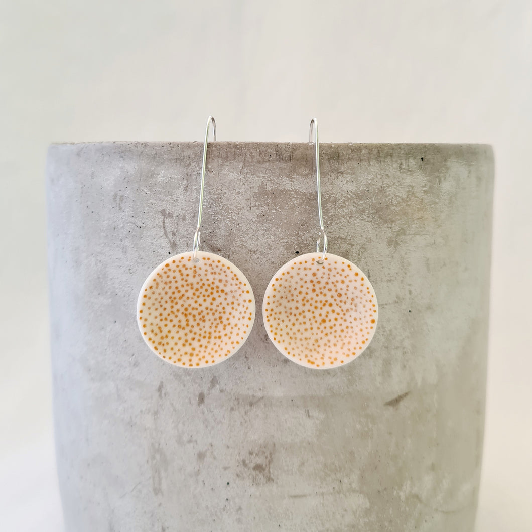 mustard yellow tiny dots on salt white | medium concave circle | earrings