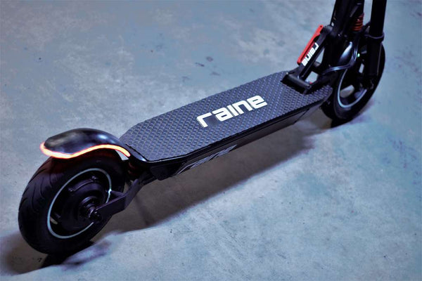 Close up of carbon fibre scooter frame and deck