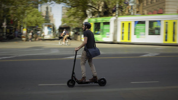 Man riding electric scooter in City