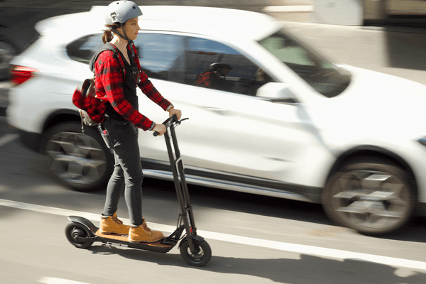 Woman riding fast electric scooter