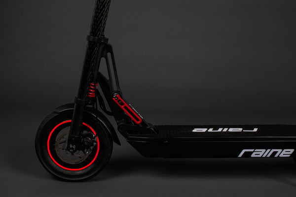 Electric scooter front wheel and deck