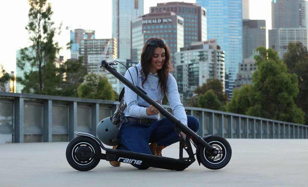 Woman opening foldable electric scooter