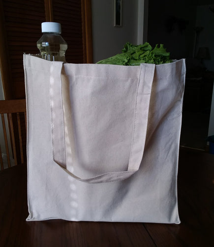 Picture of one 100% Cotton Canvas Gusseted shopping/tote bag filled with groceries
