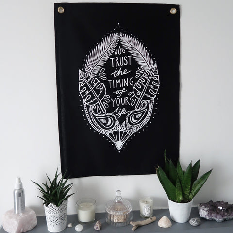 trust the timing of your life wall hanging - black