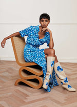 Fabienne-Chapot-Mia-Blue-Pansy-Ladies-Belted-Maxi-Dress-Model-Sitting-Ribbon-Rouge-Ireland.