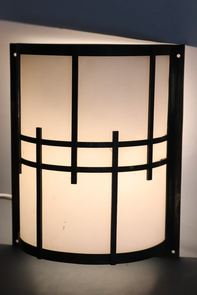 A simple grid with a light standing entrance
