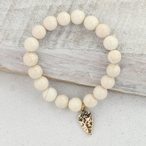 Cream Stone Bracelet with Gold Arrowhead