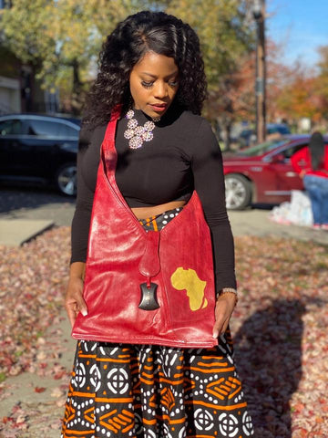 https://glamorouschicksheadwraps.com/products/africa-print-red-100-leather-handbag?_pos=7&_sid=661e2288c&_ss=r