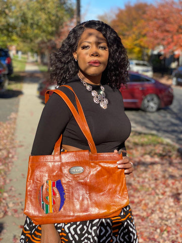 https://glamorouschicksheadwraps.com/products/brown-african-print-100-leather-handbag?_pos=6&_sid=569fe1482&_ss=r