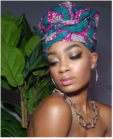 https://glamorouschicksheadwraps.com/products/best-selling-gigi-gye-nyame-gold-print-slip-on-satin-lined-headwrap?_pos=4&_sid=ae4cdbfc8&_ss=r