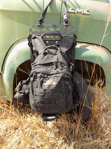 Outdoor Survival Gear - Tough hook with backpack next to old truck - Wilderness Survival Systems : Picture