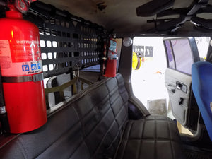 Outdoor Survival Gear - 19.25 X 10.5 RMP in the back of jeep with fire extinguishers - Wilderness Survival Systems : Picture