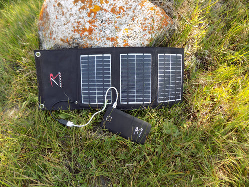 Survival - Solar Panel and Power Powerpack on Rock - Wilderness Survival Systems : Picture