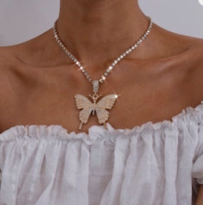 Model wearing butterfly pendant tennis necklace in gold