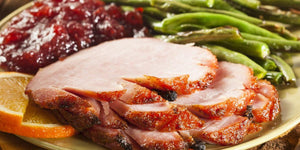 The Cook-Your-Own Apricot Glazed Ham Dinner - comes with 3 sides, a salad and 2 Desserts