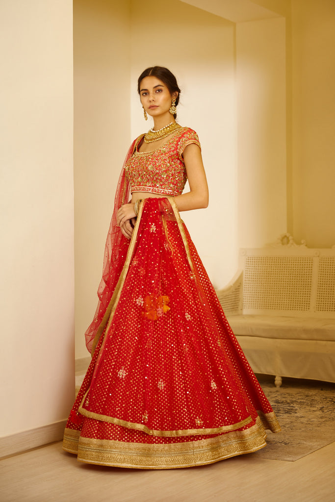 Orange Red Lehenga Set.