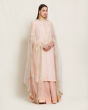 Peach pink kurta & skirt set.