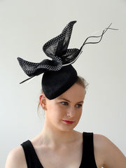 sculptural hat in black with black and white trim