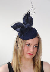 Navy lace hat with straw bow and quill detail