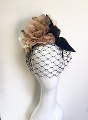 veiled floral and felt headpiece by sassy millinery
