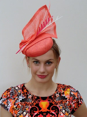 sinamay hat with cut feather feature