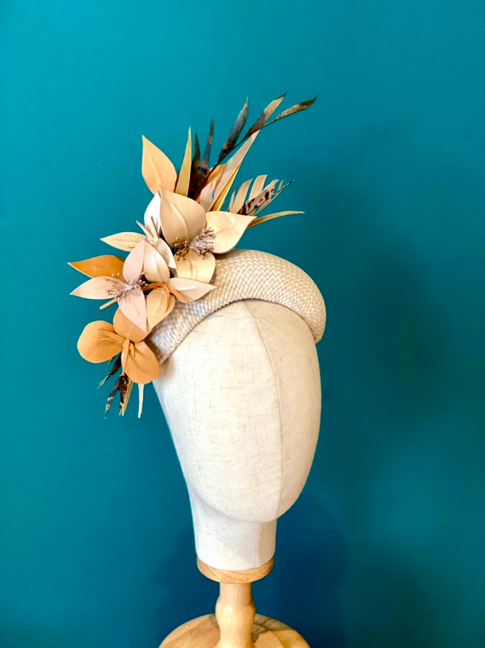 leather floral and feather headpiece