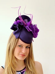 felt hat with floral and feather feature