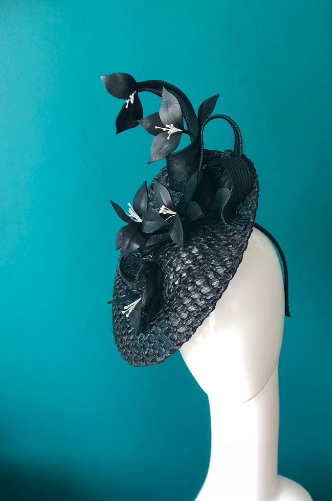 black woven disc hat with leather feature