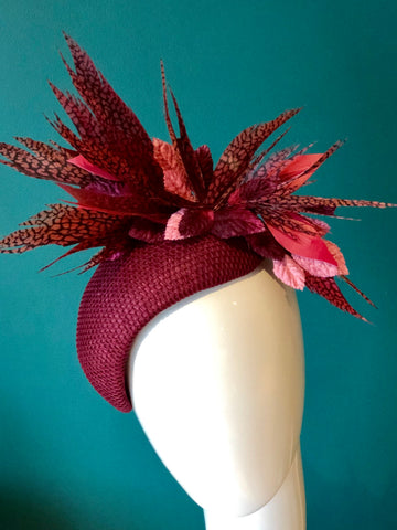 burgundy feathered headpiece