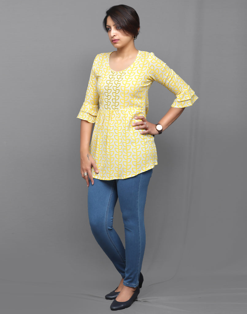 Pastel Yellow Hand Embroidered Short Kurti