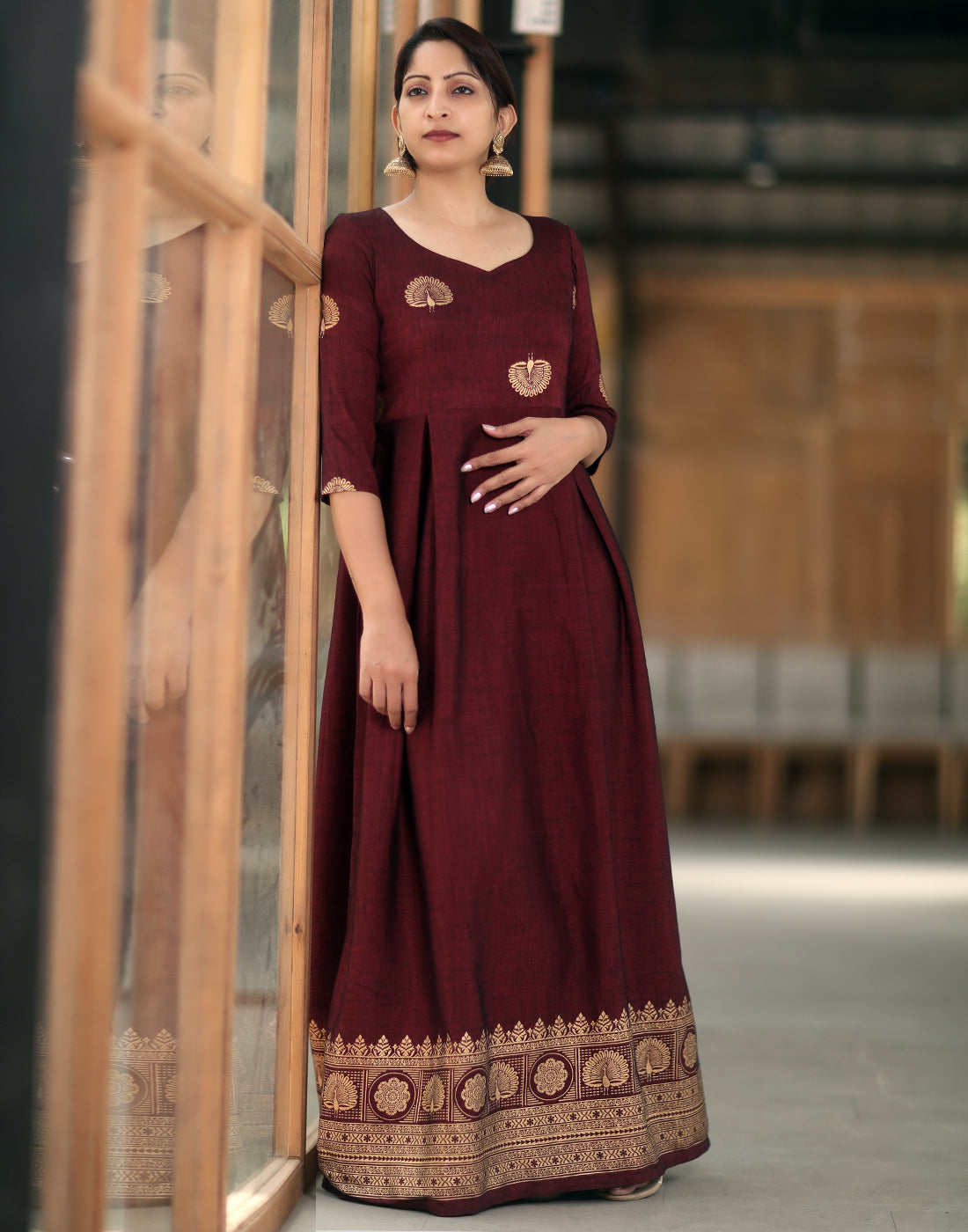 Ravishing Maroon Maxi Gown with Peacock Prints