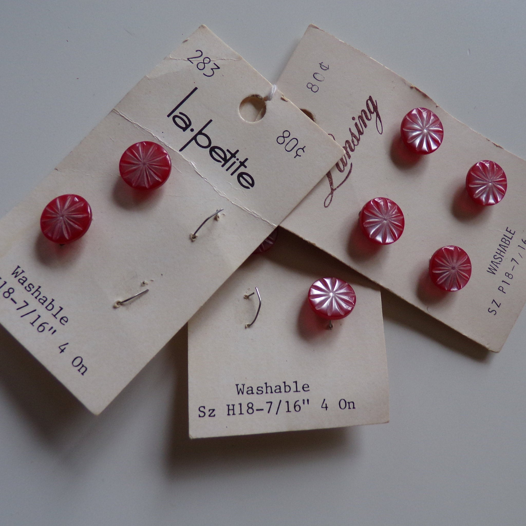 lot of 9 LA PETITE BUTTONS on cards 1950's 1960's starburst pink