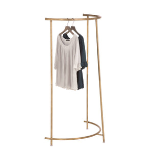 semi circular clothes rail in an antique brass patina finish