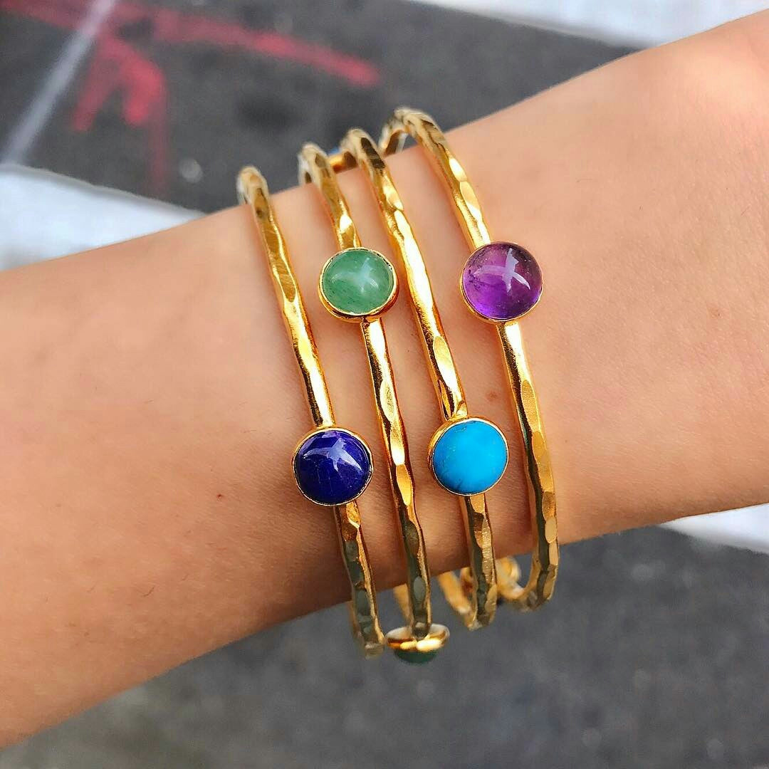 Hammered and gold-dipped stacking bangles set with 3 semi-precious gemstones.