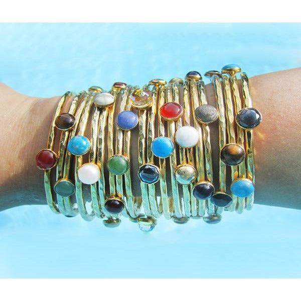 Hammered and gold-dipped stackable bangles set with 3 semi-precious gemstones.