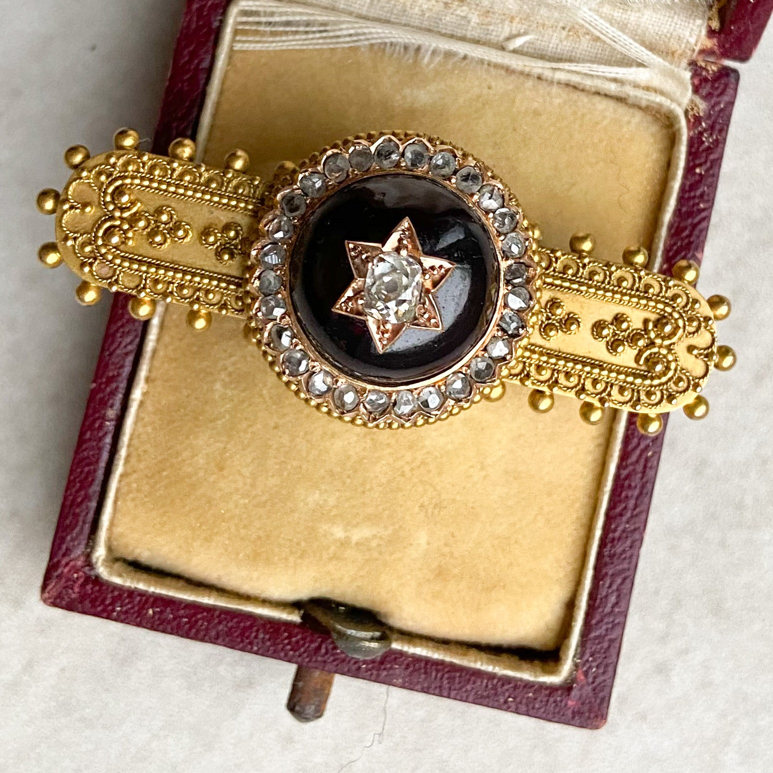 Victorian Etruscan Revival Garnet and Diamond Star Brooch