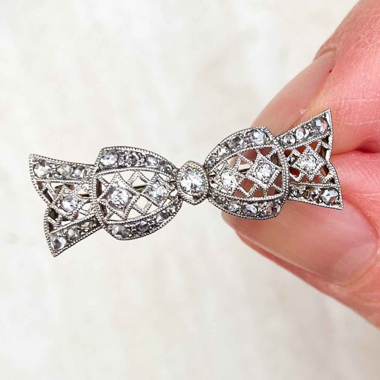 Layaway for RMcGrath: Edwardian, Platinum and 0.20ct Diamond Bow