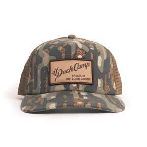 DUCK CAMP WOODLAND TRUCKER HAT