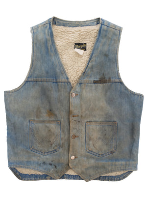dirty + distressed wrangler shearling denim vest