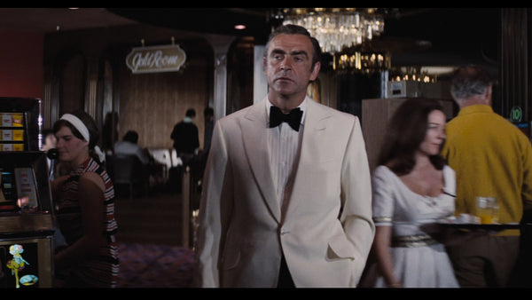 Sean Connery in classic ivory white dinner jacket and oversized butterfly bow tie